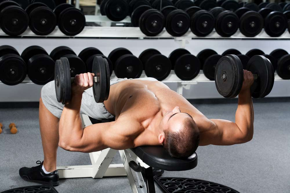 Bench pressing With A Pair Of Dumbbells